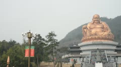 Giant buddha statue with hill background Stock Footage