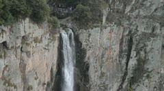 waterfall on mountain cliff - stock footage