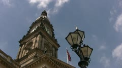 Bolton town hall clock and lamp low angle viewpoint Stock Footage