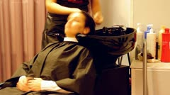 girl wash hair (head) in a hairdressing salon - stock footage