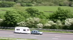 Car and Caravan on M6 motorway near Tebay - stock footage