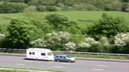 Stock Video Footage of Car and Caravan on M6 motorway near Tebay