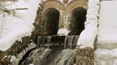 Retro creek dam archs snow water flow winter Stock Footage