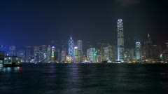 Hong Kong Island Illuminated city skyscrapers nautical vessels, Asia, Time Lapse Stock Footage