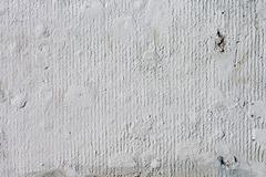 Stock Photo of Background high detailed fragment stone white wall