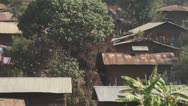 Stock Video Footage of mud wood huts, corrugated metal roof Ethiopia,  Typical Village, Africa