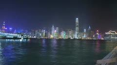 Hong Kong Illuminated city skyscrapers nautical vessels, Victoria Harbor, Time Stock Footage