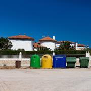 colored garbage bins to separate and recycle - stock photo