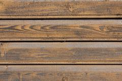Old yellow wood wall background Stock Photos