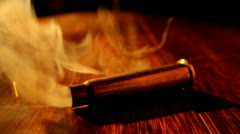 Stock Video Footage of Smoking Bullet  Casing Sparks HD Video
