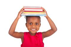 Adorable african little girl with book Stock Photos