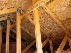 insulated attic from trusses - stock photo