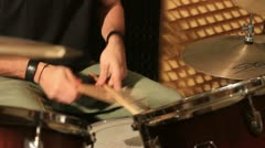 Active drummer playing at drums set in a studio Stock Footage