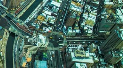 Aerial time lapse of snow capped Tokyo buildings - stock footage
