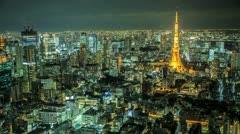 Tokyo skyline time lapse at night with the Tokyo tower illuminated Stock Footage
