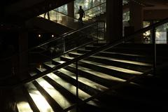 Man silhouette climbing up stairs Stock Photos