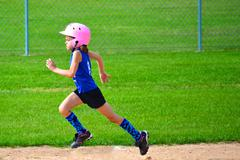 Young Girl Running Bases in Softball Stock Photos