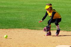 Softball Player Fielding a Ground Ball - stock photo