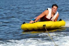 Teenage Mukula Looking Back to Boat Wake Kuvituskuvat