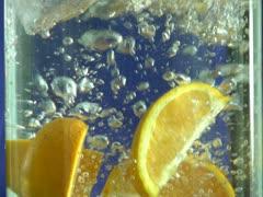 Oranges in water - stock footage