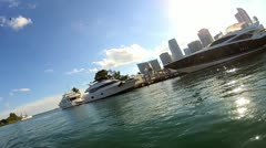 Luxury motor yachts moored Miami waterfront, USA Stock Footage