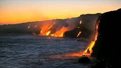 Molten lava pouring into oceans waters at dawn Kilauea Hawaii, Time Lapse Stock Footage