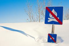 Stock Photo of funny signpost in snowdrift