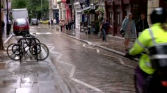 Motorcycle rides down Cobblestone street City of London Stock Footage