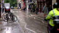Stock Video Footage of Motorcycle rides down Cobblestone street City of London