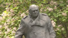 Statue of Winston Churchill in Parliament Square, London - stock footage