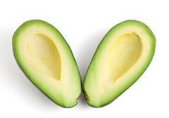 Avocado halves Stock Photos