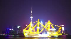 Illuminated skyline and cityscape in Shanghai at night in riverbank, time lapse. Stock Footage