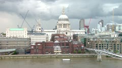 City of London, Millennium bridge and St. Paul's cathedral at  Stock Footage