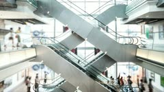 people taking escalator in shopping mall, time lapse. - stock footage