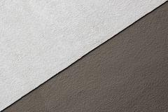 Two tones brown texture on concrete wall, triangle shape Stock Photos