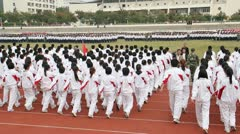 pan China Chinese college students unified synchronized marching drills assembly - stock footage