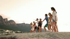 Young party people dancing on a rock Stock Footage