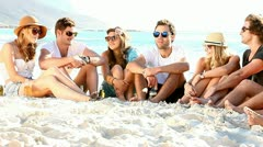 Young hipster people enjoying a beach party with guitar music Stock Footage
