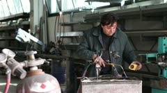 Man working with the blowtorch - dolly Stock Footage