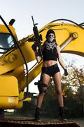 Beautiful girl with weapon and mask Stock Photos