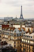 Eiffel tower over the roofs Stock Photos