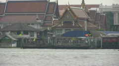 A River Taxi Arrives at Tewet Pier, Bangkok p116 Stock Footage