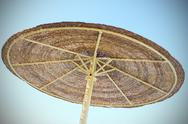 Parasol and blue sky with vignetting Stock Photos