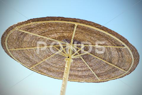 Stock photo of Parasol and blue sky with vignetting