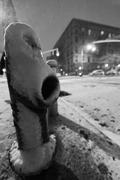 Snow covered fire hydrant & harlem manhattan street at night Stock Photos