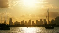 Stock Video Footage of Sunset Miami nautical vessels against the Miami skyline, USA