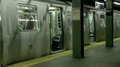 L Train Bedford Avenue platform people board doors close Stock Footage