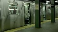 L Train Bedford Avenue platform people board doors close Stock Footage