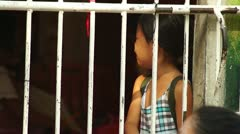 Crying Girl behind iron bars Stock Footage