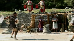 Costumed actors reenact a Greek or Roman hand to hand combat fight. - stock footage